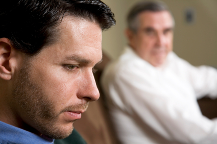 Close Up of Depressed Man with father looking on How Inner Wisdom Helped Tom Move beyond a Childhood Vow to Succeed in a New Job